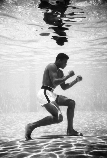 Cassius Clay training in a pool at the Sir John Hotel in Miami